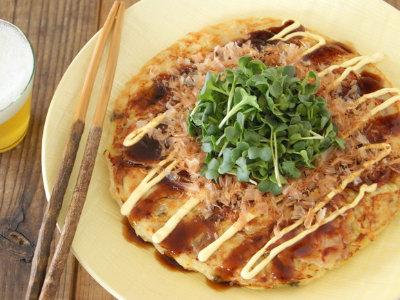 Fluffy okonomi-yaki pancakes with fresh, crisp radish sprouts and cabbage